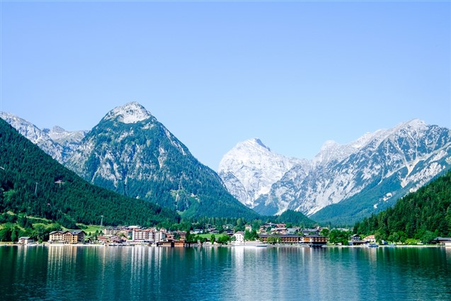 A view accross Lake Achensee of the snow covered Pertisau Mountain in Austria
